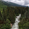 Crossing over river rapids on the White Pass & Yukon Route.<br /> Skagway, AK.<br /> July 13, 2010.