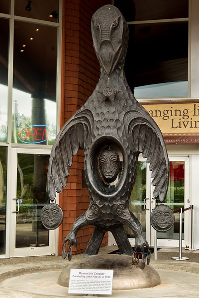 """Raven the Creator,"" by John Hoover.<br /> Sculpture in the front of the Alaska Native Heritage Center, Anchorage, AK.<br /> July 4, 2010."