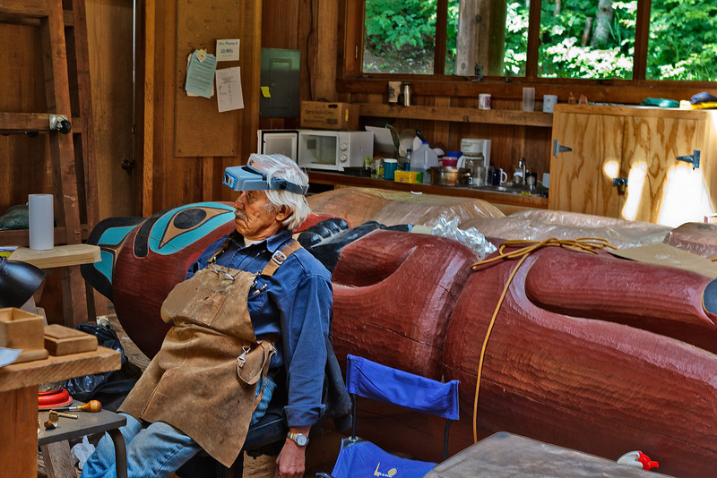 Totem artist stops to talk with us in the Carver's Shed.<br /> Saxman Totem Park, Ketchikan, AK.<br /> July 15, 2010.