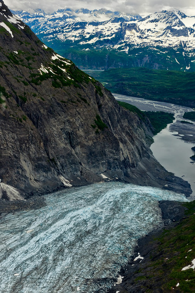 Glacier forms a silty river, viewed from our floatplane.<br /> Wasilla to Talkeetna, AK.<br /> July 4, 2010.