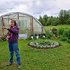Janel Porterfield among the flower and vegetable gardens show grows on her family homestead.<br /> Trapper Creek, AK.<br /> July 5, 2010