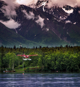 Float plane coming in for a landing on Lucille Lake, Wasilla Alaska, 7/4/10