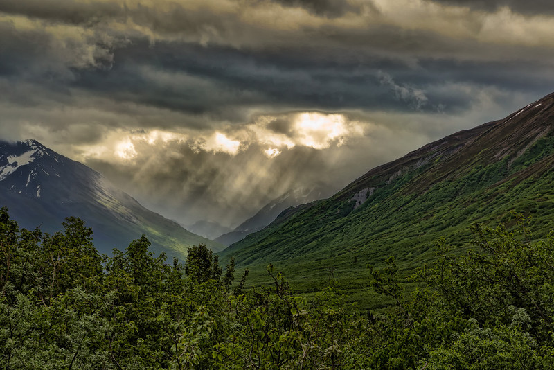 Sunlight glowing through the clouds in a glacial valley.<br /> Viewed on our Richardson Highway drive from Wrangell - St. Elias National Park to Valdez, AK.<br /> July 10, 2010