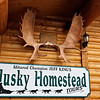 Entrance to the Husky Homestead Lodge owned by Iditarod Champion Jeff King and his wife, artist Donna Gates King.<br /> Denali, AK.<br /> July 6, 2010.