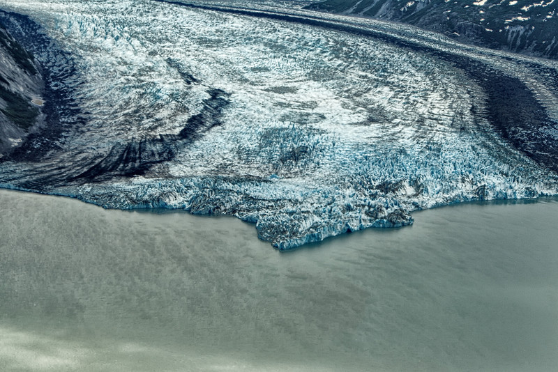 Glacier forms a silty river.<br /> View from our floatplane.  <br /> Susitna River Valley, AK.<br /> July 4, 2010.