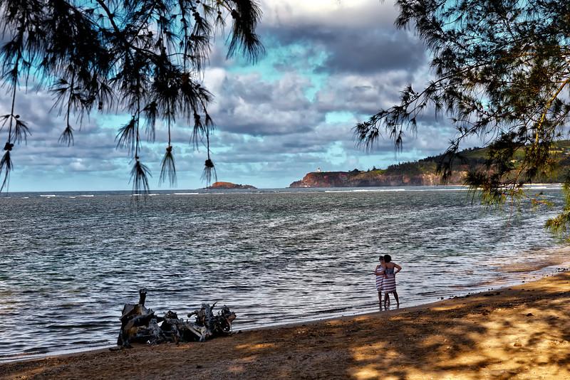 Kauai: A section of Anini beach with Kilauea lighthouse in the far distance.
