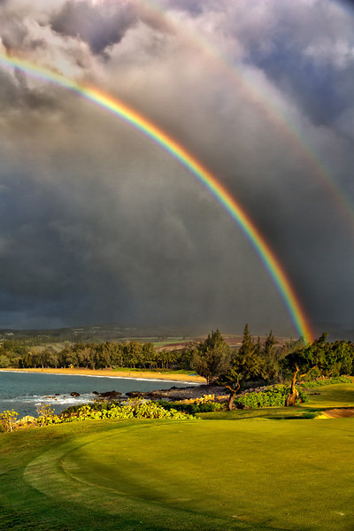 Maui:  Spectacular double rainbow over Kapalua Beach as rain moves in.