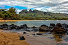 "Kauai: Nice beach with a view of the rock formation known as the ""sleeping giant"" in the distance."