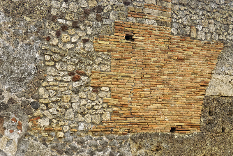 Wall with various stonework patches - Pompeii Italy