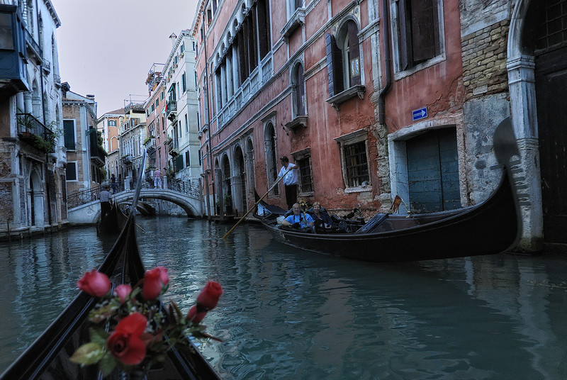 Gondola ride through canals of Venice Italy