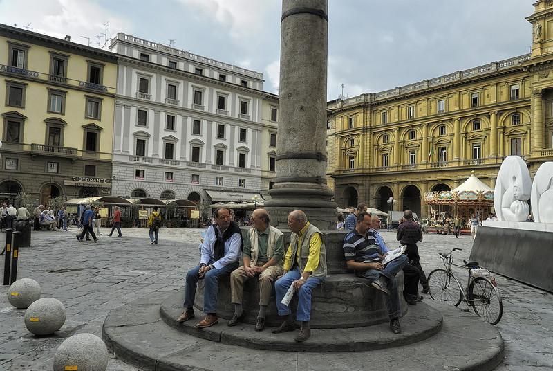 Italian men talking in piazza in Florence Italy
