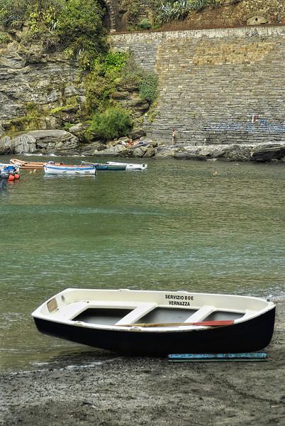 Lone boat in Cinque Terre Italy Harbor