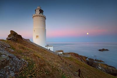 Start Point Lighthouse and full moon, Devon