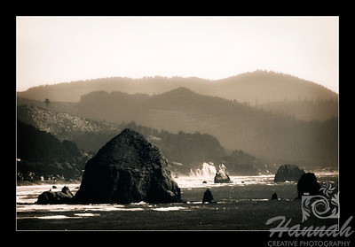 Cannon Beach, Oregon Coast ... View of the rock formations and Haystack Rock in monochrome with framed black border Shot from the Ecola State Park  © Copyright Hannah Pastrana Prieto