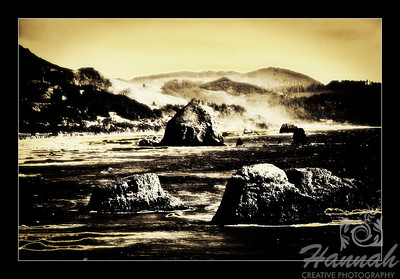 Cannon Beach, Oregon Coast ... View of the rock formations and Haystack Rock with framed black border Shot from the Ecola State Park  © Copyright Hannah Pastrana Prieto