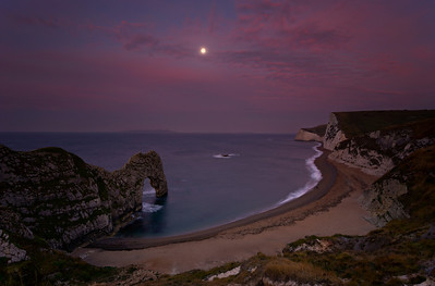 Durdle Door at Dawn with full Moon