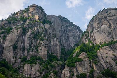 Towering granite walls in Val di Mello in the Italian Alps.