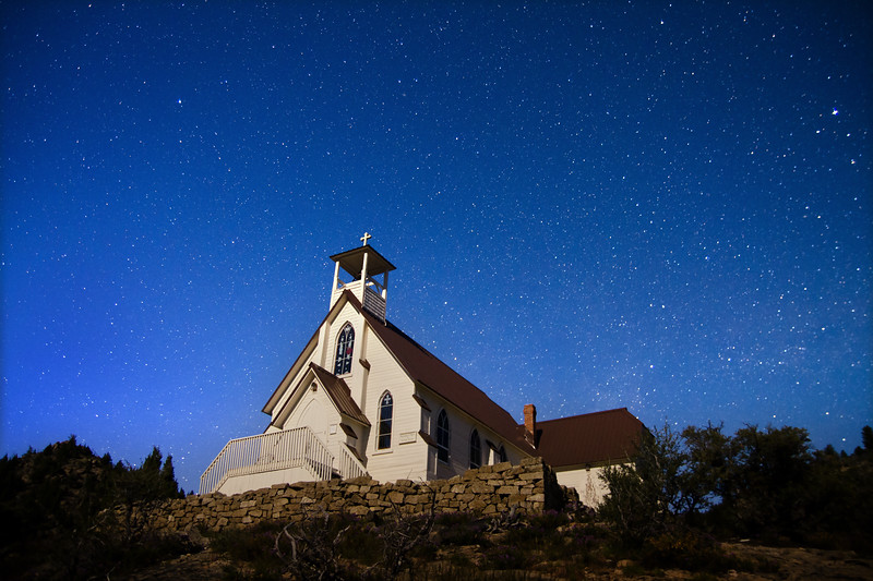 Moonlight shines on Our Lady of Tears Catholic Church in Silver City, Idaho.