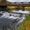 """Beaver Dam: Conant Creek""<br /> <br /> About This Image: One of the many beaver dams on Conant Creek.  This bridge is a few miles North of Drummond, Idaho.    It was the beavers along Conant Creek that attracted many of the first trappers to the area.   The beaver quickly became scarce but are now a common site along Conant Creek and the Henry's fork river.    <br /> <br /> Photographs Available: See the drop down menu to the upper right for a list of print sizes and prices for this photo"