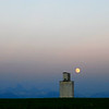 Untitled <br /> <br /> About This Image:   The July full moon rises behind the grain elevator in Lamont, Idaho.   <br /> <br /> Photographs Available:  See the drop down menu to the upper right for a list of print sizes and prices for this photo.   <br /> <br /> Recommended Sizes:   Panoramic <br /> 4x8<br /> 5x10<br /> 8x16<br /> 10x20<br /> 12x24