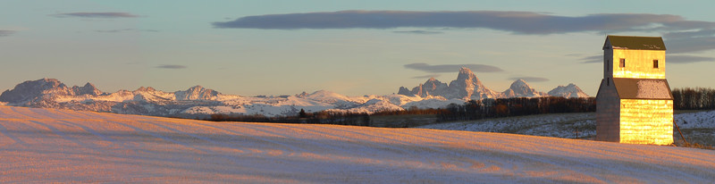 "December Light: Panoramic<br /> <br /> About This Image:   The setting December sun reflects off the Tetons and the grain elevator at France, Idaho.     <br /> <br /> Photographs Available:  See the drop down menu to the upper right for a list of print sizes and prices for this photo.   <br /> <br /> Recommended Sizes:   Panoramic <br /> 10x30<br /> <br /> For an un-cropped print choose ""None"" for cropping options.   <br /> For any questions please e-mail me at chris@leavellphoto.com"