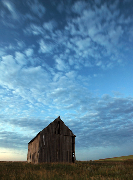 """Untitled""<br /> <br /> About This Image: Evening light reflects off clouds and an old barn on farm land near Squirrel, Idaho.   <br /> <br /> Photographs Available: See the drop down menu to the upper right for a list of print sizes and prices for this photo"