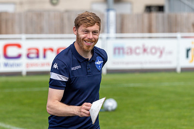 Jason Brookes warms up the players before the match between Eastleigh and Barnet in the Vanarama National League at The Silverlake Stadium, Eastleigh UK on 15th May 2021. Image by Graham Scambler Photography