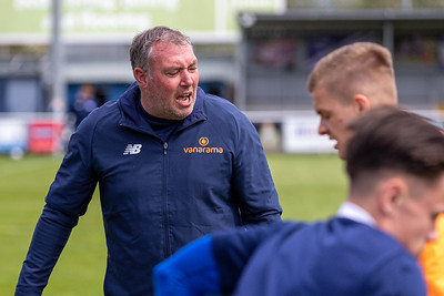 Jason Bristow warms up Eastleigh players before the match between Eastleigh and Barnet in the Vanarama National League at The Silverlake Stadium, Eastleigh UK on 15th May 2021. Image by Graham Scambler Photography