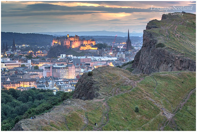 Edinburgh Castle floodlit at dusk, from Arthur's Seat