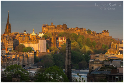 Edinburgh Castle in the first rays of dawn sunshine, from Calton Hill