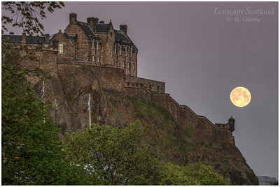 Full moon setting over Edinburgh Castle