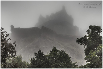 Edinburgh Castle in the mist, from West Princes Street Gardens