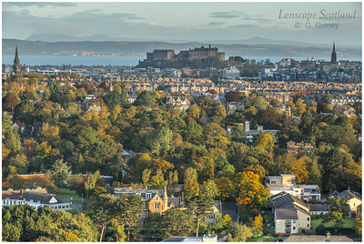 Edinburgh Castle from Blackford Hill with trees in autumn colours
