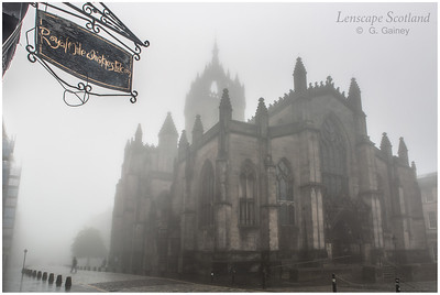 Saint Giles Cathedral and Royal Mile Whiskies hanging sign in the mist
