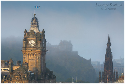 Balmoral Hotel clock tower, Edinburgh Castle and Scott Monument with early morning haar