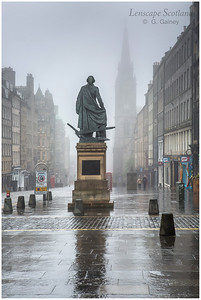 Adam Smith statue and Tron Kirk in the mist