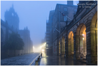 Saint Giles Cathedral and the City Chambers arches in the mist