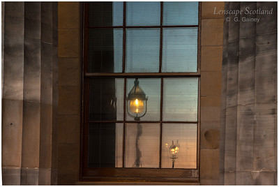 Lamps reflected in window of Royal Scottish Academy