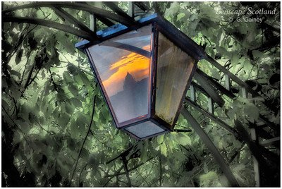 West Register House dome at sunset reflected in lamp at Lady Stair's Close