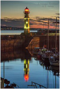 Newhaven lighthouse reflection on a summer night