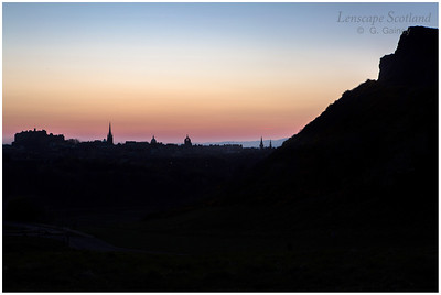 Edinburgh Castle and Salisbury Crags sunset silhouette, from Holyrood Park