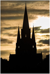 Spires of St Mary's Episcopal Cathedral backlit by the late afternoon sun
