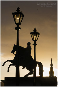 Duke of Wellington statue in silhouette at sunset
