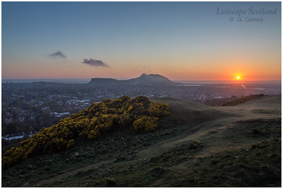 Sun rising over Arthur's Seat and East Lothian, from Blackford Hill