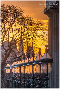 Row of lamps outside the Royal Scottish Academy at sunset