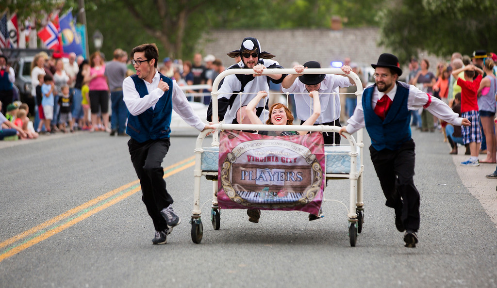 Virginia City players race a mattress