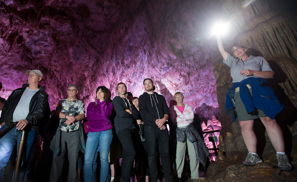 Pam Schroeder guides tourist throught the caverns