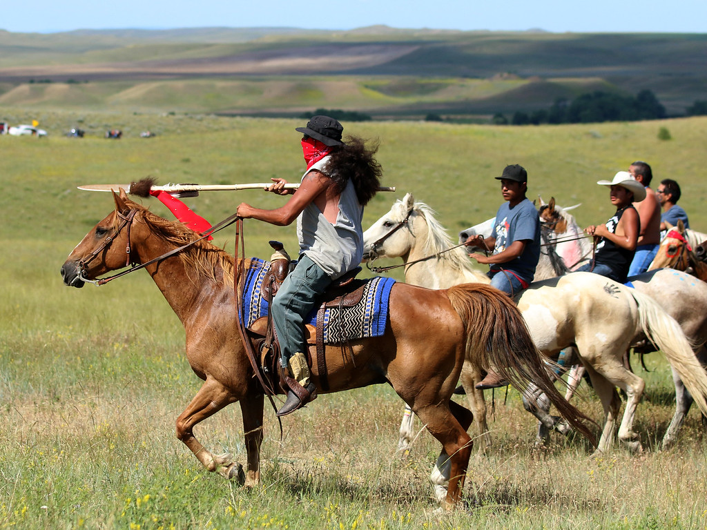 Ogala Sioux member Terry Richards rides in the Morning Charge