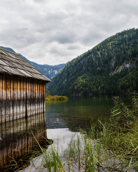 Old Boat House and Hills on a Lake in Austria