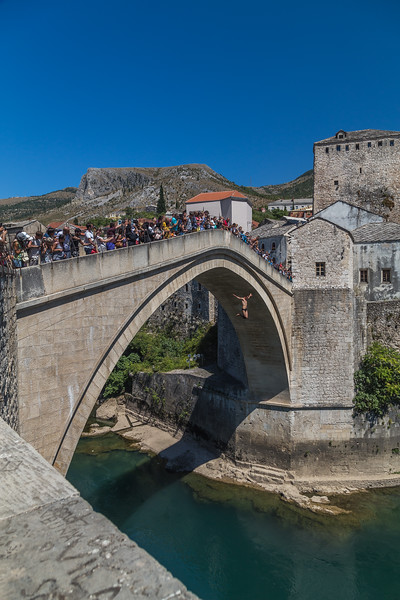Man jumping Stari Most in Mostar